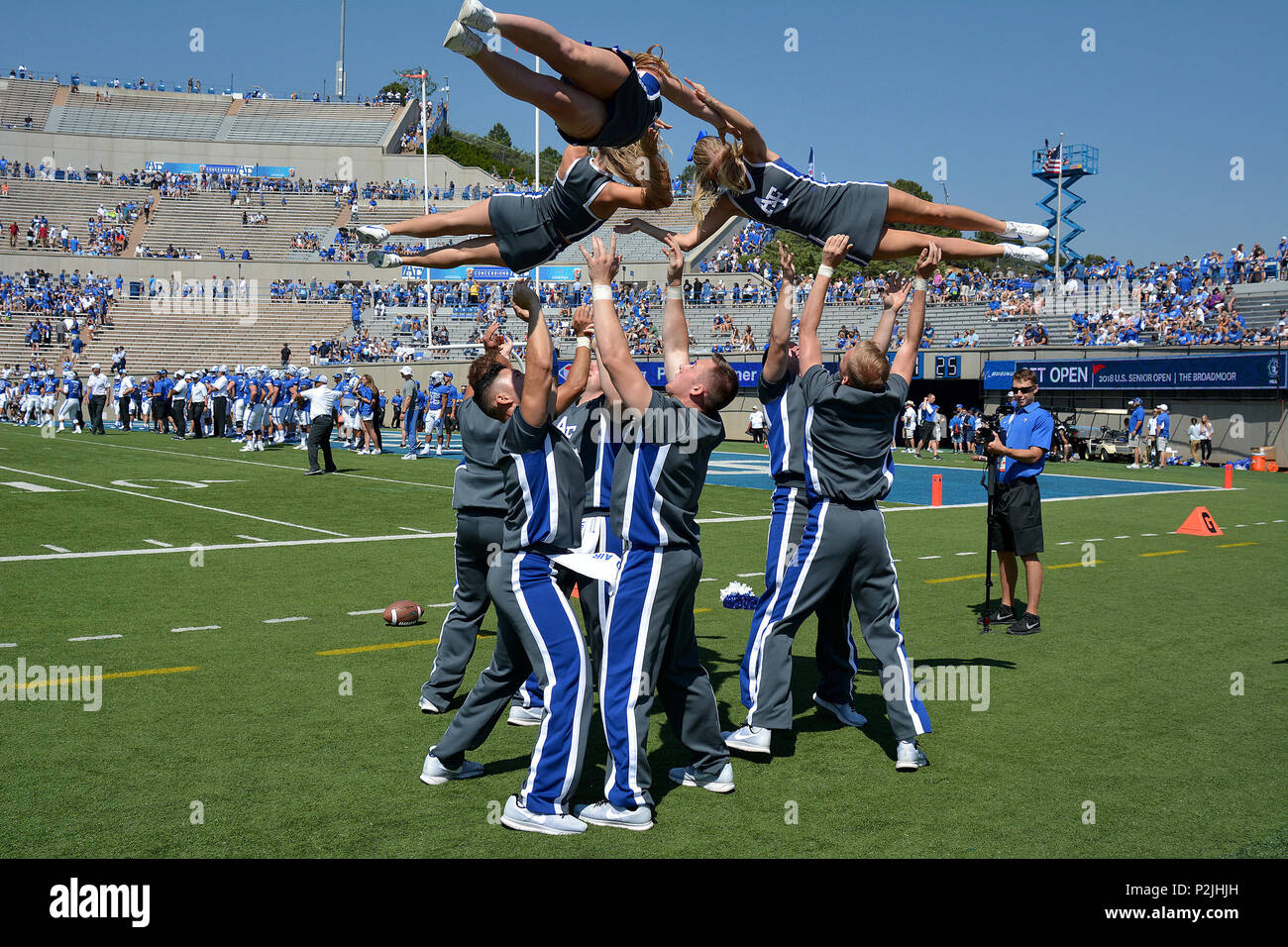 The Air Force Cheer Team entertains the crowd during pre-game warmups before the Air Force vs. Virginia Military Institute football game at Falcon Stadium at the U.S. Air Force Academy, Colo., Sept. 2, 2017. The Falcons defeated the Keydets 62-0, moving to 11-0 in season openers under head coach Troy Calhoun. (U.S. Air Force photo/ Jason Gutierrez) (released) - Stock Image