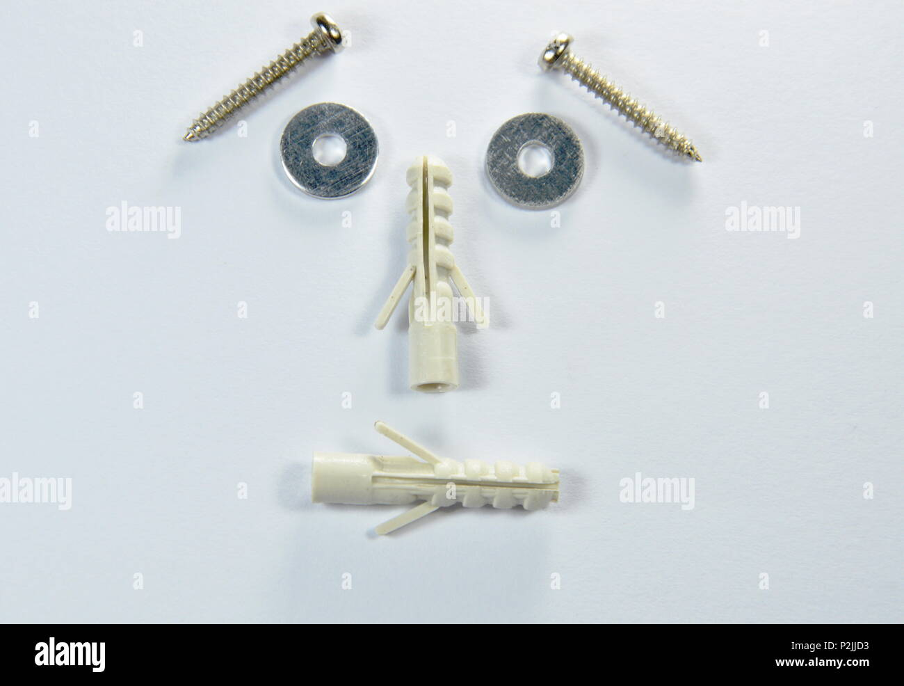 screw nut alignment worry face - Stock Image