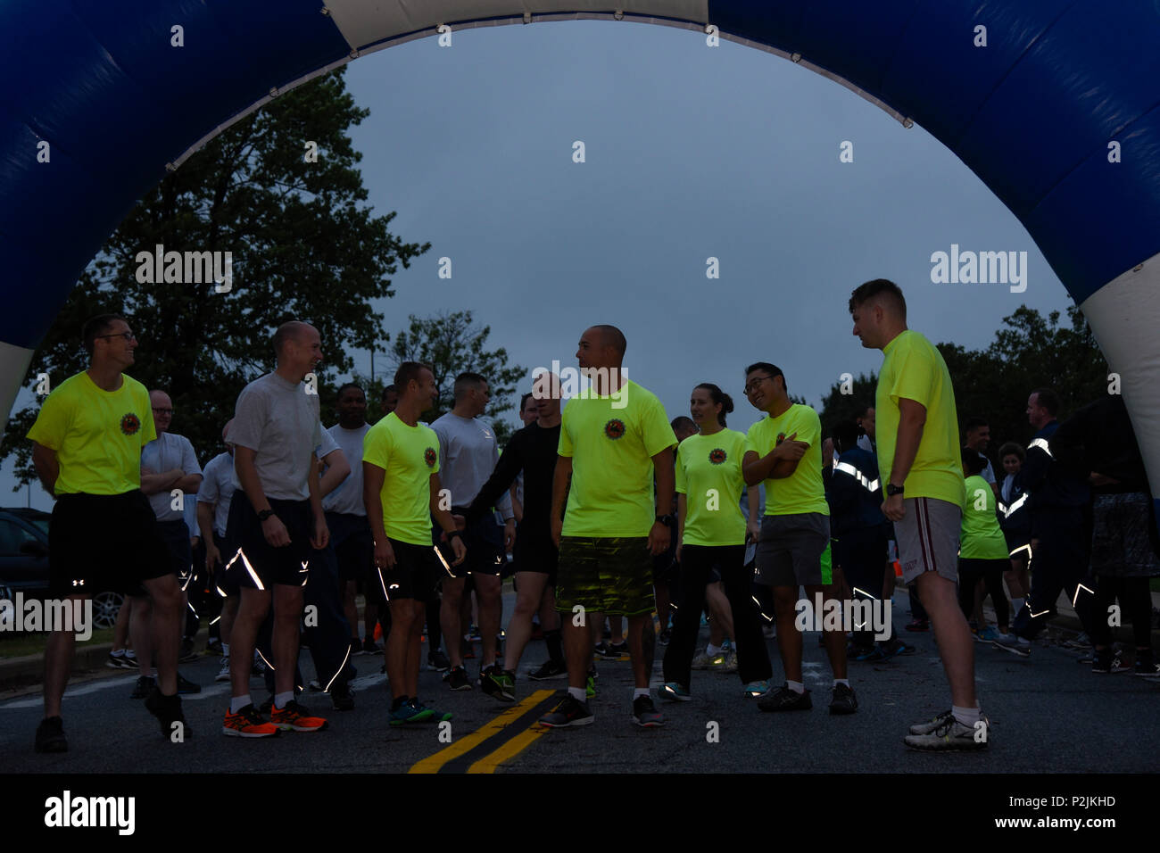The 11th Civil Engineering Squadron and 11th Security Forces Group participate in the National Preparedness Month 5K at the West Fitness Center on Joint Base Andrews, Md., Sept. 30, 2016. NPM provides a time for readiness and emergency managers to share their knowledge about plans for emergency situations. The run, hosted by 11 CES, had a turnout of more than 50 JBA members. (U.S. Air Force photo by Airman 1st Class Valentina Lopez) - Stock Image