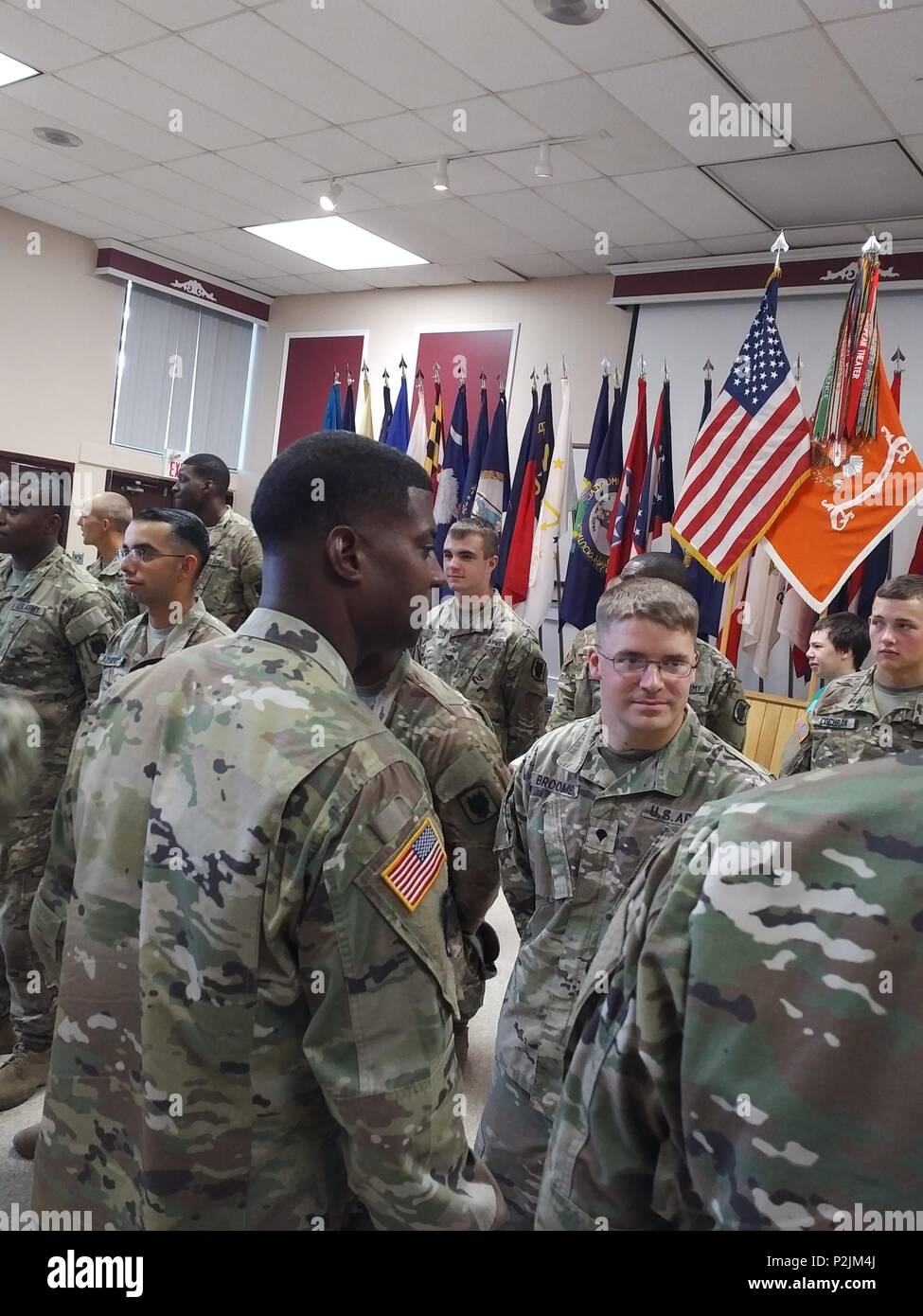 Battalion Command Sergeant Major Barrett speaks with the deploying Soldiers about his expectations and the opportunity this deployment presents. Soldiers pictured, from left to right, SPC Sinclair, SPC Ambrocio, SPC Broome, SGT Brady, SPC Gittens, SPC Hinz, PFC Cochran - Stock Image