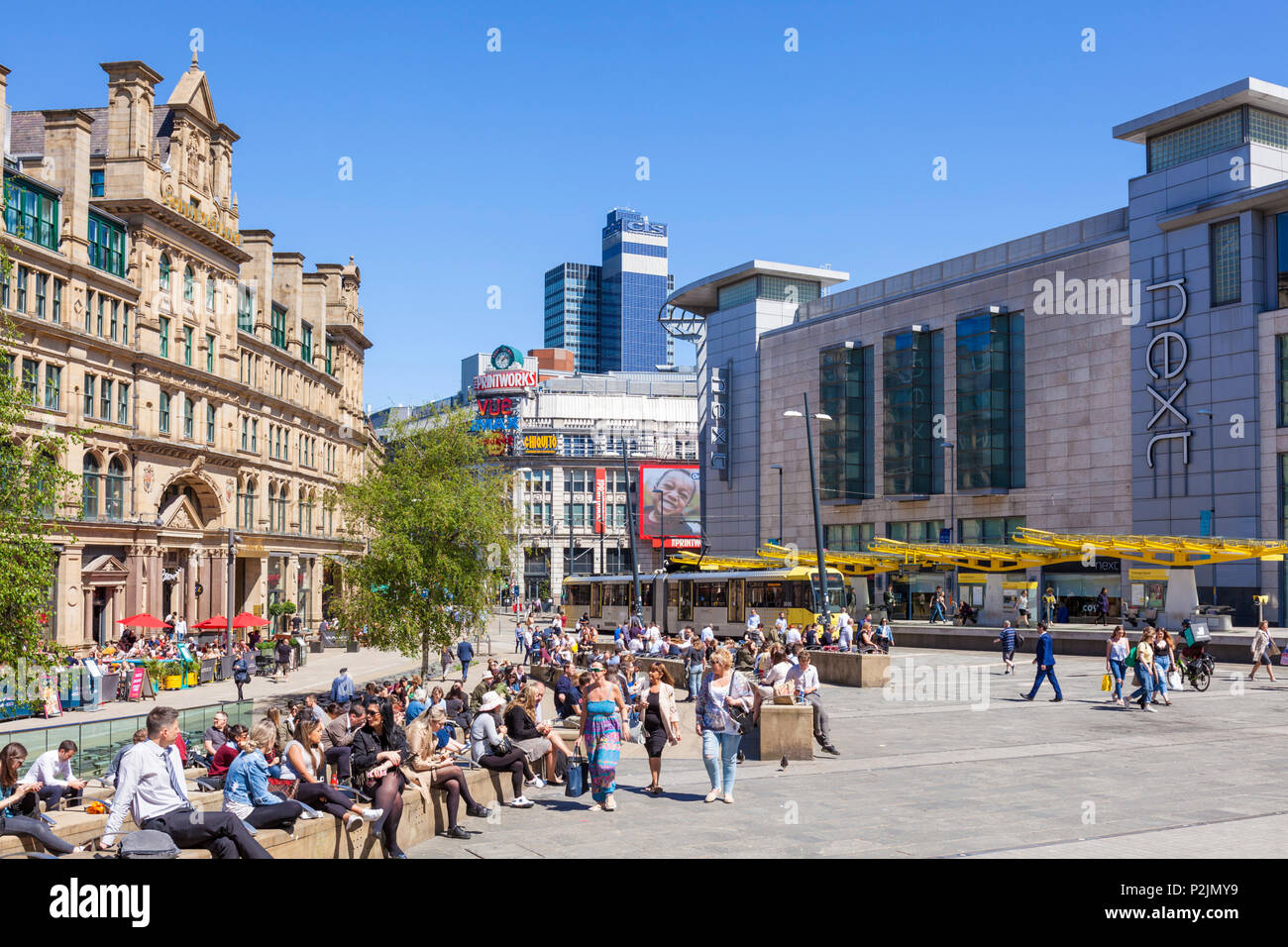 England Manchester England Manchester City centre city center shoppers outside Next store exchange square manchester Arndale centre Manchester uk - Stock Image