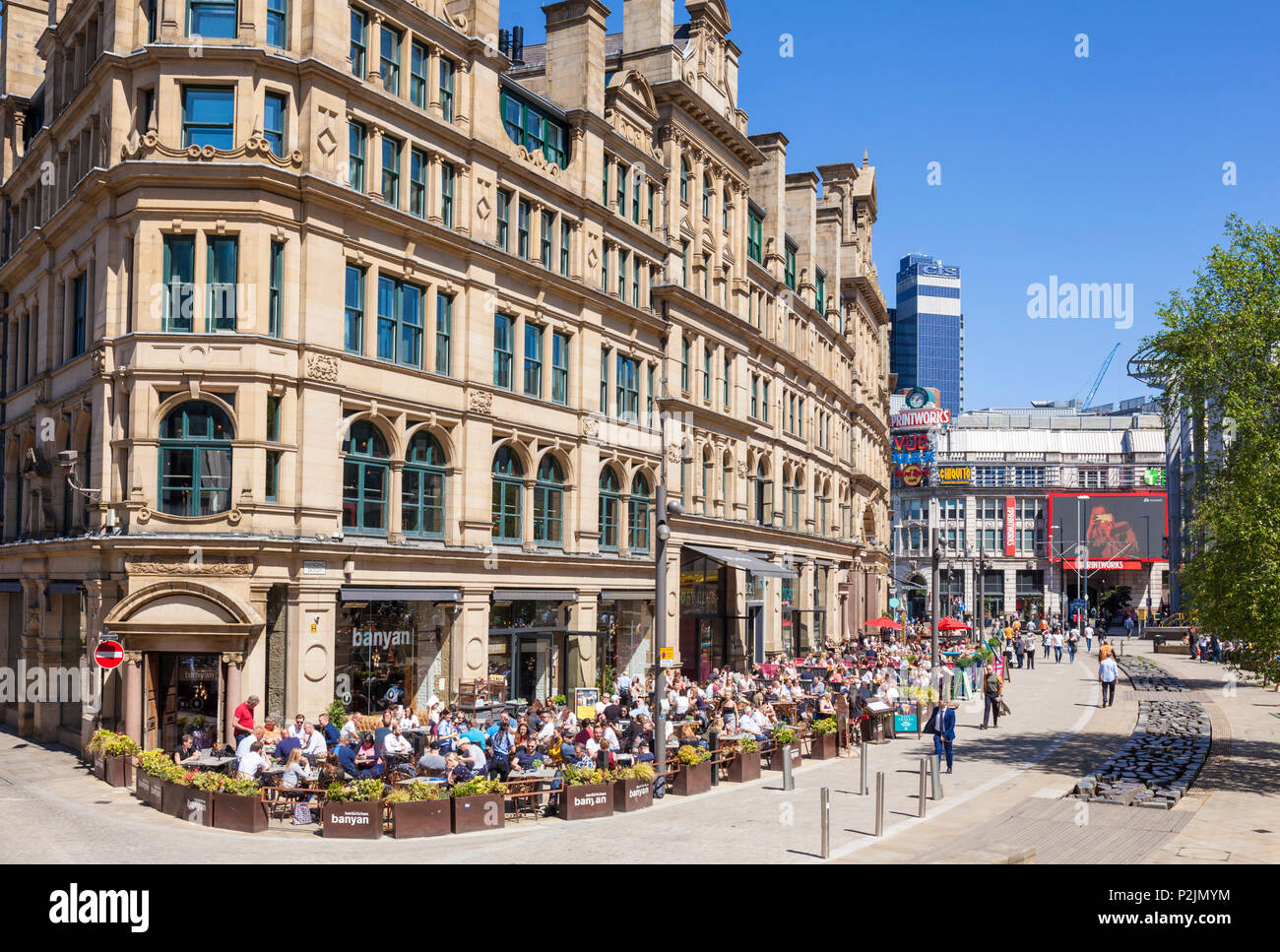 England Manchester England greater Manchester City centre city center people enjoying dining outside in the Exchange square manchester city centre uk - Stock Image
