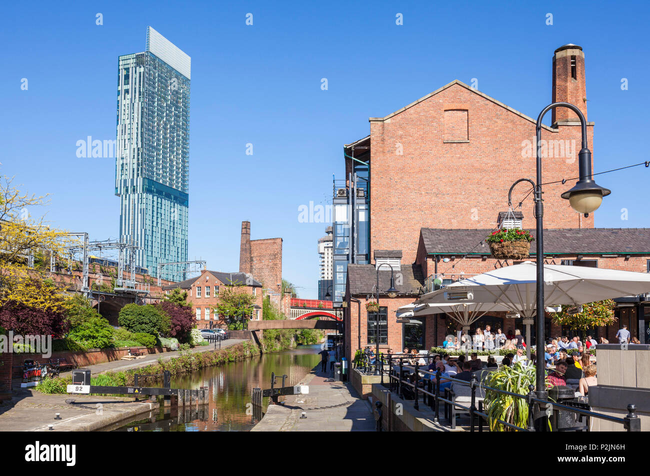 England Manchester England greater Manchester City centre city center view of the beetham tower and bridgewater canal with canal towpath manchester uk - Stock Image