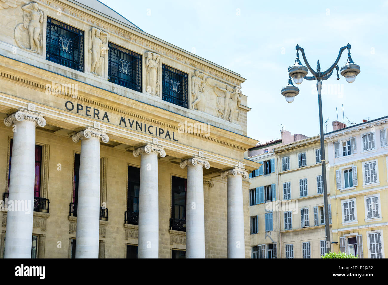 View of the facade of the municipal opera of Marseille with neoclassical-style peristyle topped by an Art Deco pediment. - Stock Image