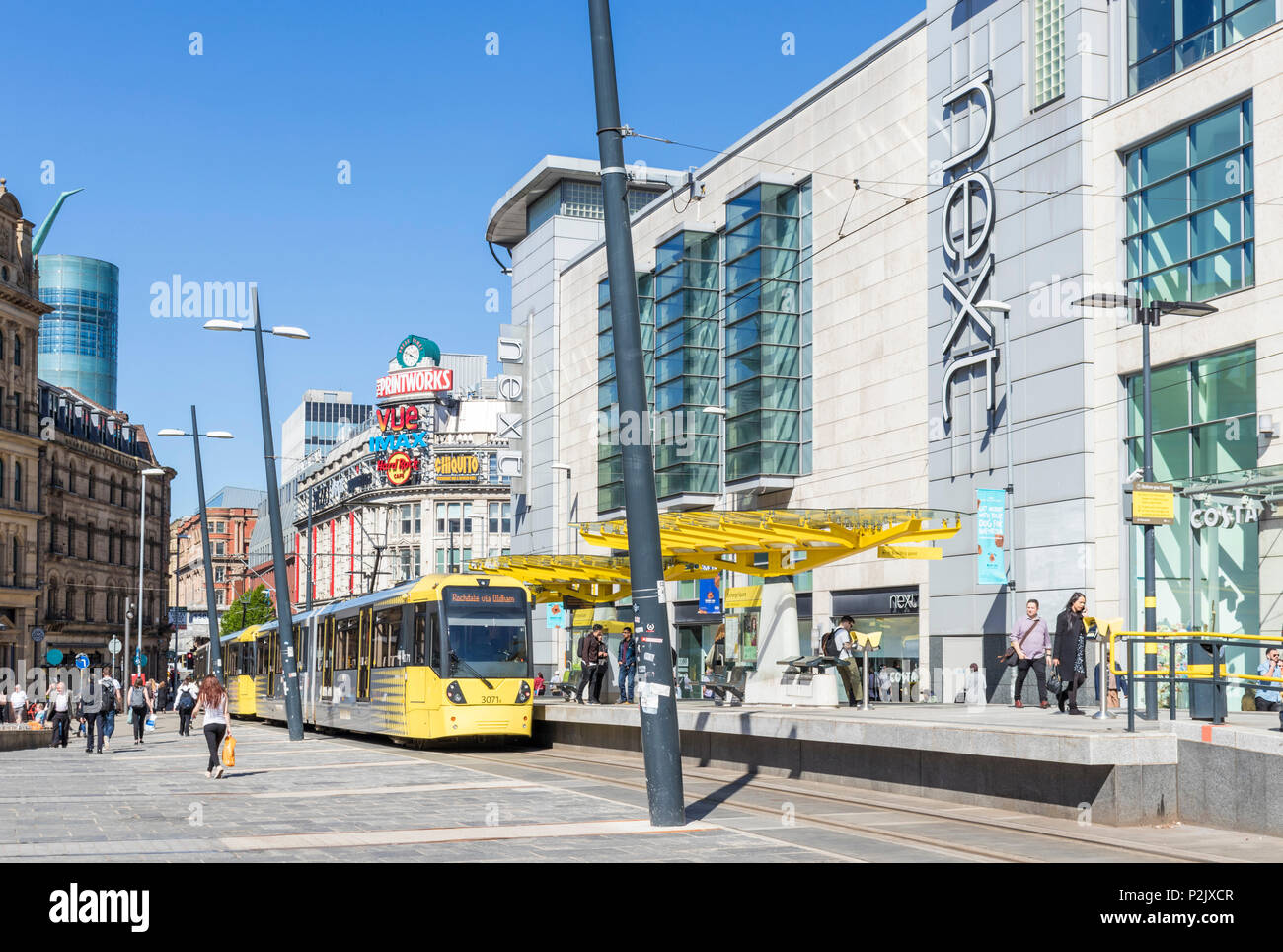England Manchester England Manchester tram stop exchange square City centre city center Next store  manchester Arndale centre Manchester uk - Stock Image