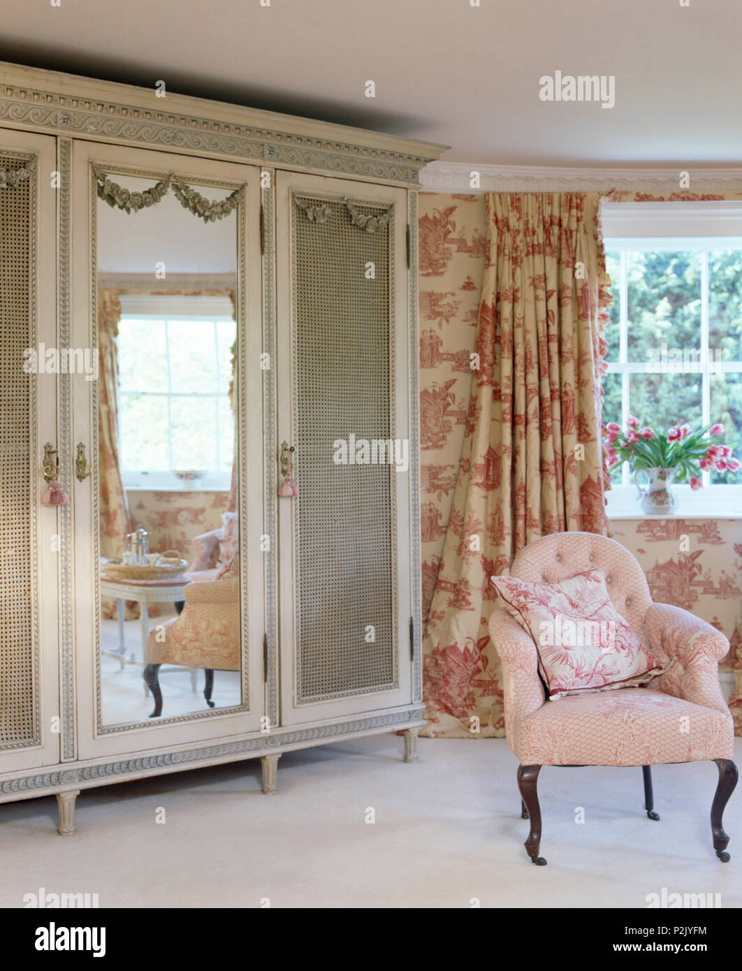 Painted French Style Wardrobe With Mirrored Door In Bedroom With Pink Toile  De Jouy Curtains And Pink Upholstered Chair