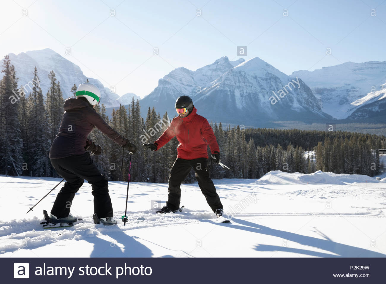Woman receiving ski lesson from ski resort instructor - Stock Image