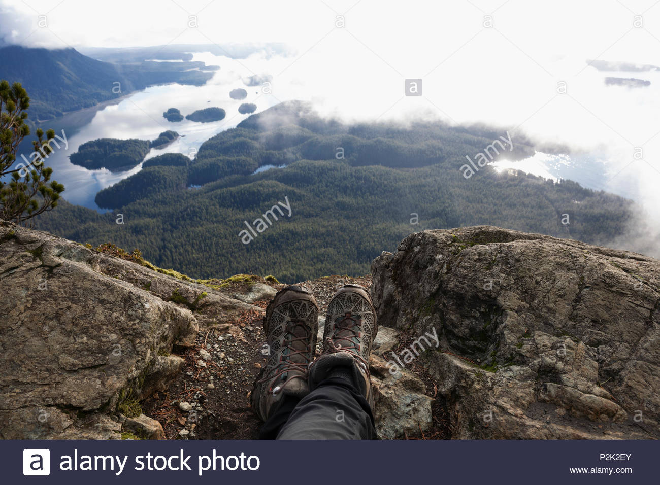 Personal perspective hiker resting, enjoying scenic view - Stock Image