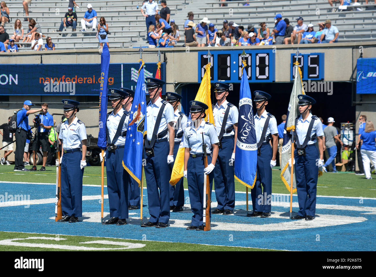 The Cadet Honor Guard enters Falcon Stadium during pre-game ceremonies before the Air Force vs. Virginia Military Institute football game at Falcon Stadium  at the U.S. Air Force Academy, Colo., Sept. 2, 2017. The Falcons defeated the Keydets 62-0, moving to 11-0 in season openers under head coach Troy Calhoun.  (U.S. Air Force photo/ Jason Gutierrez) (released) - Stock Image