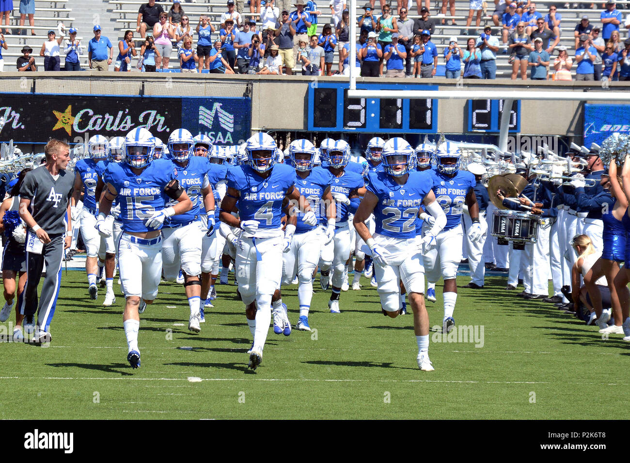 The Air Force football team enters Falcon Stadium during pre-game ceremonies before the Air Force vs. Virginia Military Institute football game at the U.S. Air Force Academy, Colo., Sept. 2, 2017. The Falcons defeated the Keydets 62-0, moving to 11-0 in season openers under head coach Troy Calhoun.  (U.S. Air Force photo/ Jason Gutierrez) (released) - Stock Image