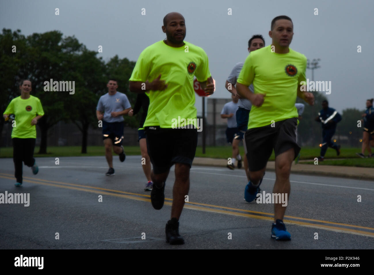 The 11th Security Forces Group and 11th Civil Engineering Squadron race to the finish line in the National Preparedness Month 5K on Joint Base Andrews, Md., Sept. 30, 2016. NPM is a time to inform installation members on techniques to use during a disaster. More than 50 runners participated in the 5K. (U.S. Air Force photo by Airman 1st Class Valentina Lopez) - Stock Image