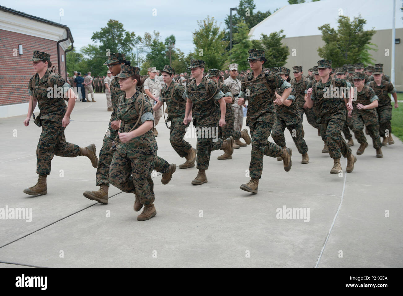 Candidates move their formation as ordered by U.S. Marine Drill Instructor Gunnery Sgt. Nickea Redding, after the Commander's Orientation, Officer Candidate School (OCS) at Marine Corps Base Quantico, Va., Sept. 15, 2016. The mission of OCS is to train, screen and evaluate candidates, who must demonstrate a high level of leadership potential and commitment to success in order to earn a commission. (U.S. Marine Corps photo by Lance Cpl. Yasmin D. Perez) - Stock Image