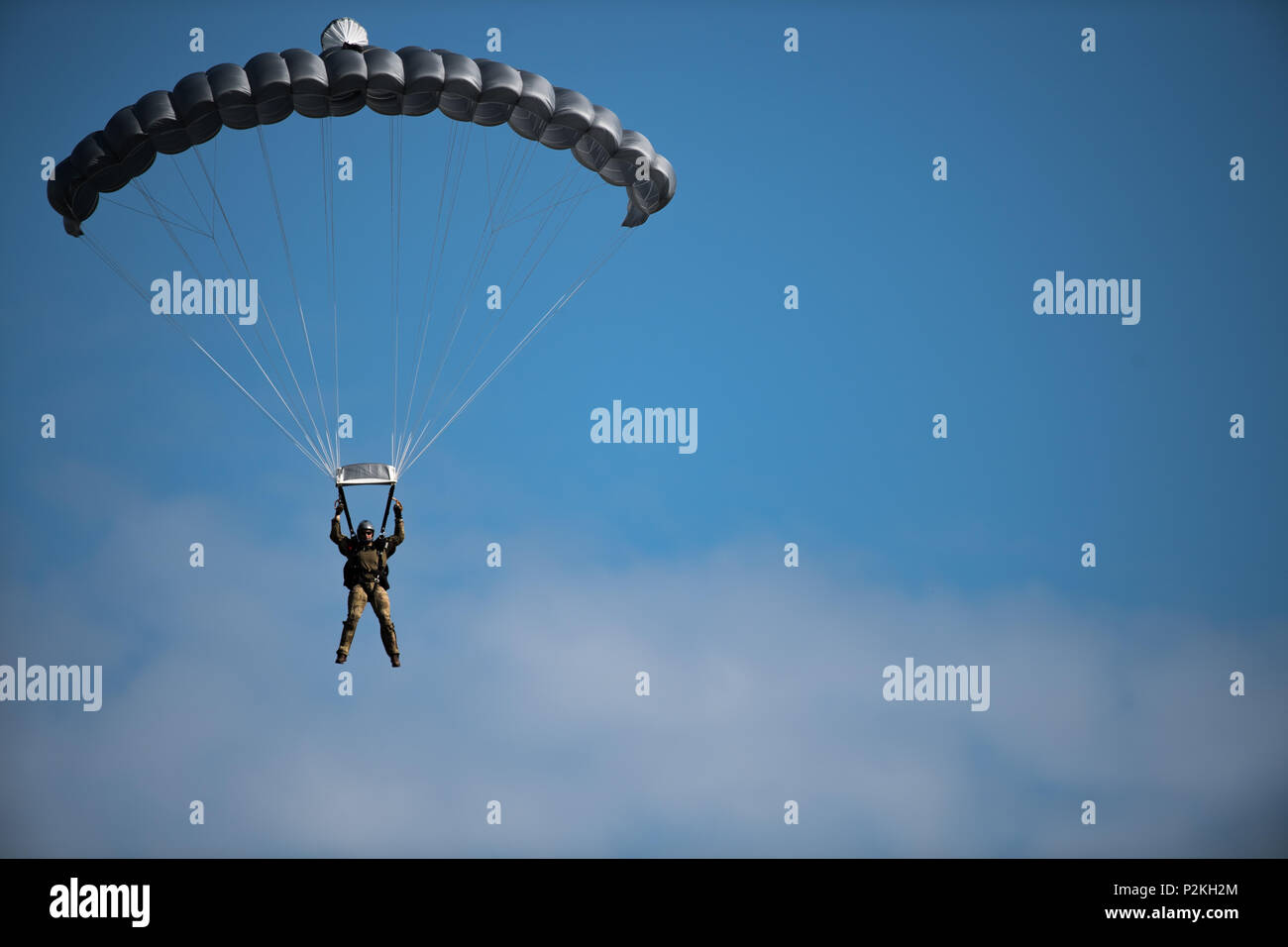 A pararescueman (PJ) glides through the air during a high-altitude, low opening (HALO) team competition in Sebastian,  Florida, Sept. 19, 2016.  The HALO jump is a method of delivering personnel, equipment, and supplies from a transport aircraft at a high altitude via free-fall parachute insertion. The event was part of the 2016 PJ Rodeo, which brought together past and present PJs from around the world, to showcase their unique mission and build camaraderie. (U.S. Air Force photo/Tech. Sgt. Brandon Shapiro) Stock Photo