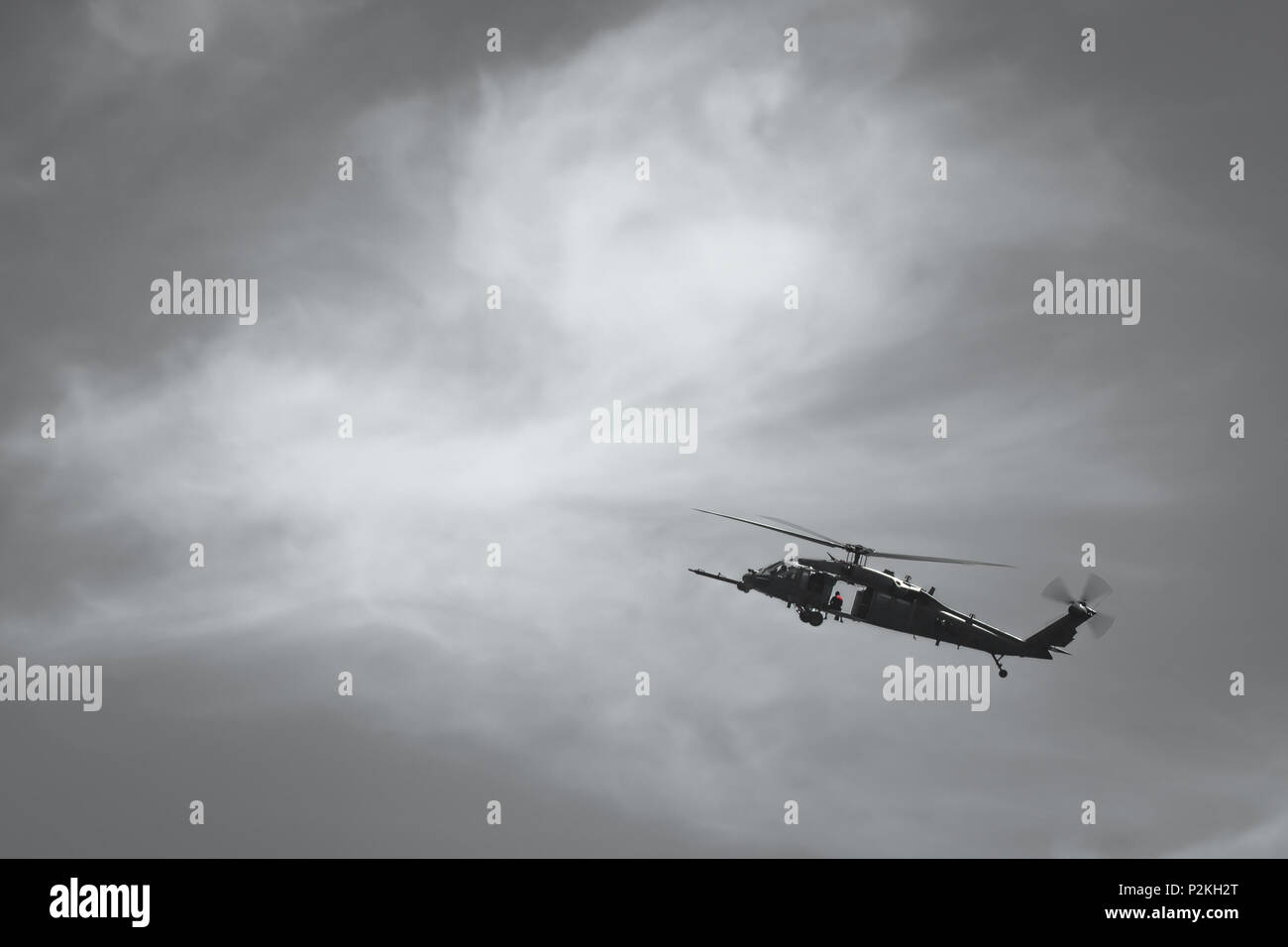 An HH-60 Pavehawk helicopter flies over Cocoa Beach, Florida during PJ Rodeo 2016 on Sept. 21, 2016. The flight was part of a pararescue (PJ) competition that challenged Airmen from different Air Force search and rescue units around the world. PJ Rodeo 2016 brought together past and present PJs to showcase their unique mission and build camaraderie.  (U.S. Air Force illustration/Tech. Sgt. Brandon Shapiro) Stock Photo