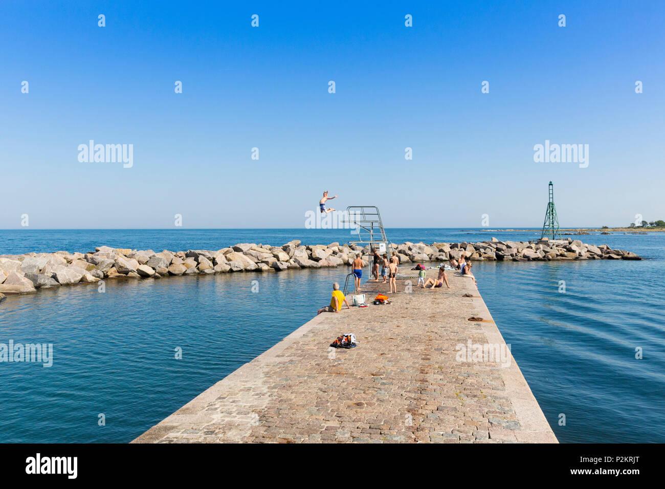 hildren at the diving platform, 5 meter tower at the harbour, summer, Baltic sea, Bornholm, Svaneke, Denmark, Europe - Stock Image