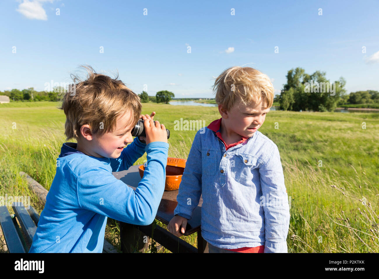 Boys with a binoculars, family bicycle tour along the river Elbe, adventure, from Torgau to Riesa, Saxony, Germany, Europe Stock Photo