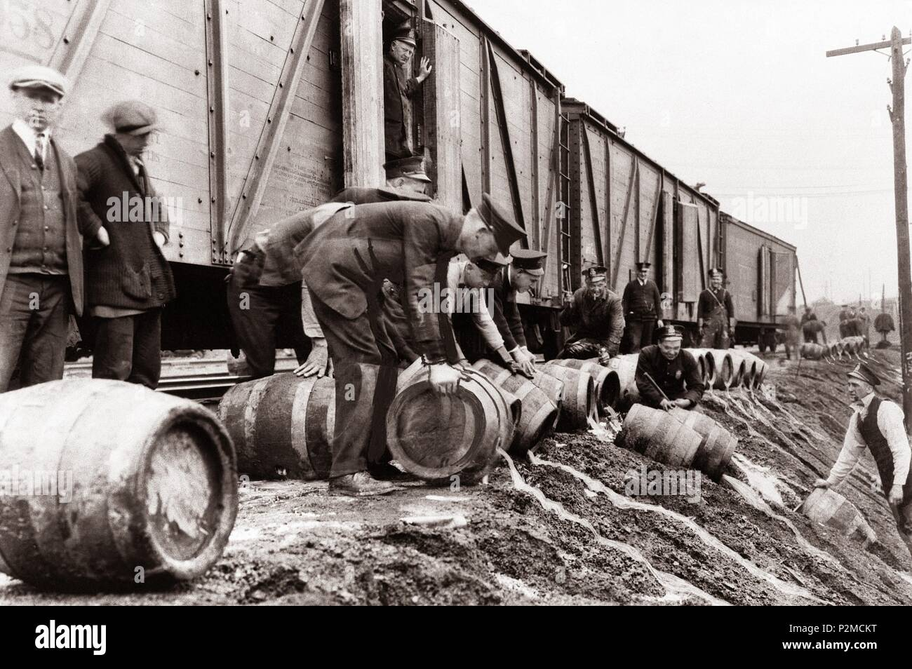 A view of the local police dumping illegal booze (Beer Barrels) off a train in Scranton, Pennsylvania during the prohibition years of 1920 to 1933. The Wilkes Barre, Scranton region of North Eastern Pa. was  the center of the Anthracite coal mining industry of the United States during the industrial revolution and a hot bed of mob activity during prohibition.Scranton was a hub of illegal liquor transportation during Prohibition.In terms of bootlegging,Scranton was full of activity.The downtown Scranton area had 147 speakeasies.Not to mention, trains were important for alcohol transportation. Stock Photo