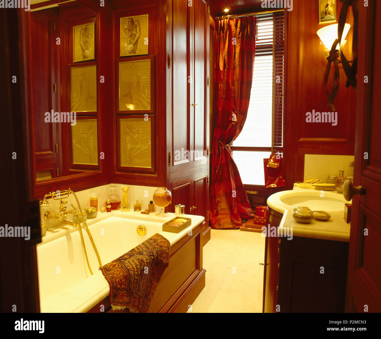 Dark Brown Panelling And Rich Red Silk Drapes In Bathroom In Elegant Paris Apartment Stock Photo Alamy