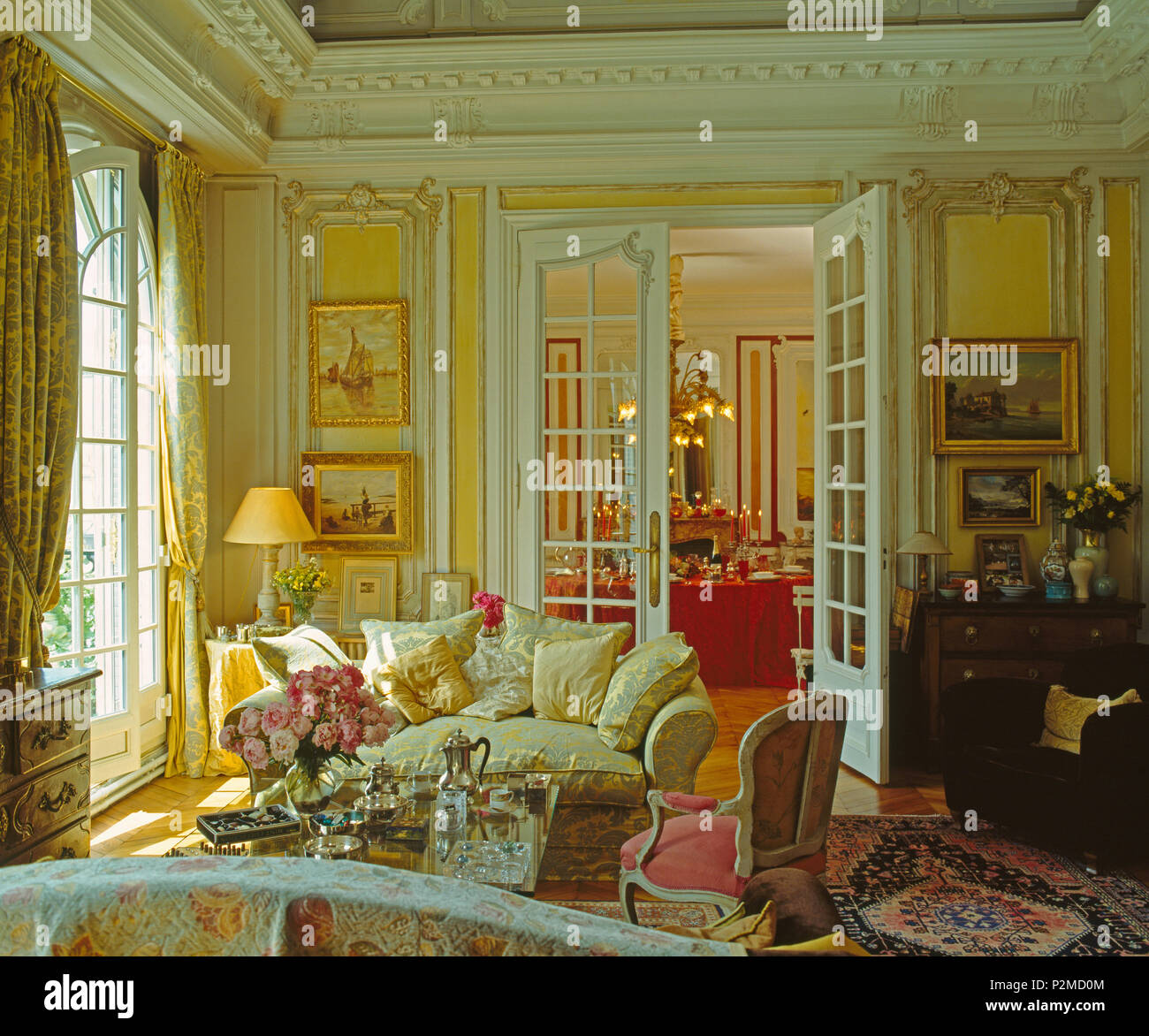 Glazed Double Doors In Elegant Drawing Room In Paris Apartment With Cream Sofa And Antique Chair Stock Photo Alamy