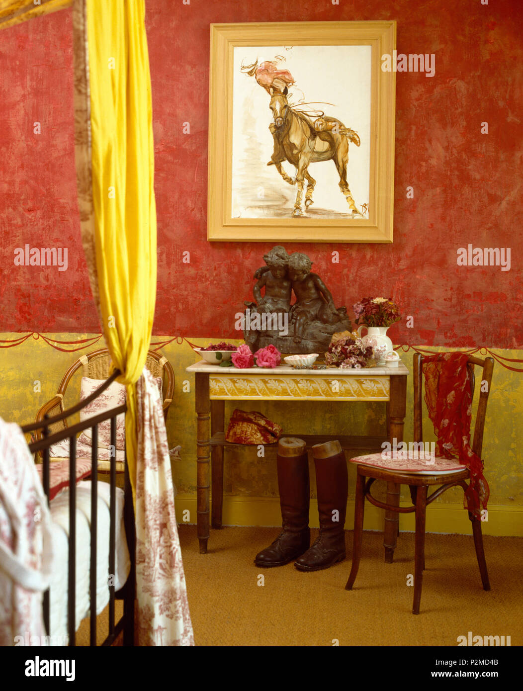 Painting On Wall Above Small Marble Topped Table With Antique Chair In Red Apartment Bedroom Stock Photo Alamy