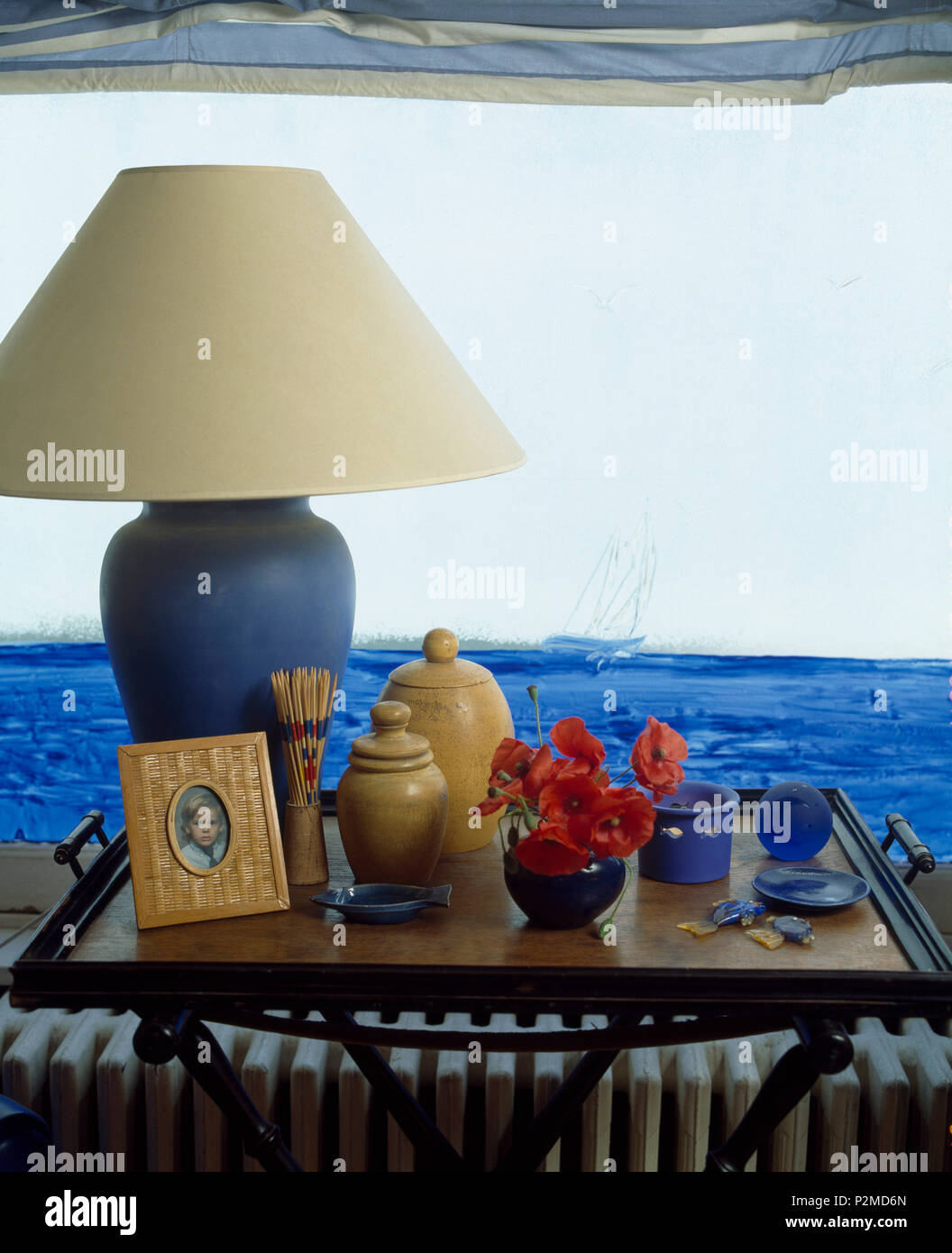 Enjoyable Blue White Lamp On Antique Tray Table With Photograph And Home Interior And Landscaping Fragforummapetitesourisinfo