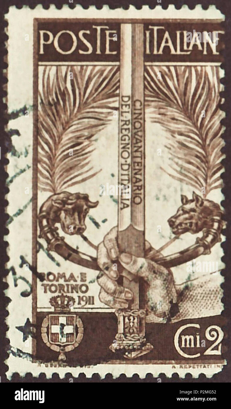 . Stamp of the Kingdom of Italy; 1911; commemorative stamp to the '50th anniversary of the Kingdom of Italy'; drawing with symbolized sword wielded by a hand, the hilt symbolizing Turin (Bull) and Rome (wolf); postmarked (last day cancellation) Stamp: Michel: No. 100; Yvert et Tellier: No. 88; Scott: No. 119 Color: brown to chest nut brown Watermark: none Nominal value: 2 Cent. (Centesimi) (This stamp was officially sold for 5 Centesimi. The non-documented surcharge was used for the organization committee for the celebrations to the 50th anniversay of the Kingdom of Italy.) Postage validity: f - Stock Image