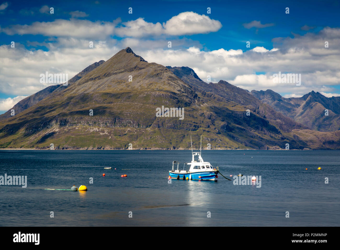 Fishing boat and the Black Cuillin Mountains from Elgol, Isle of Skye, Scotland, UK - Stock Image