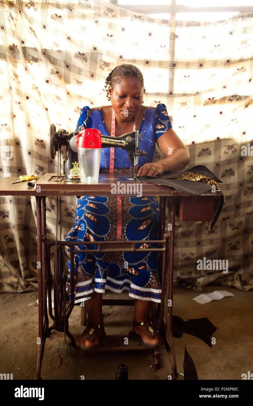Togo, Lome, MIVO energy, energy access program set up by Entrepreneurs du Monde, kit energy lamps for seamstresses - Stock Image
