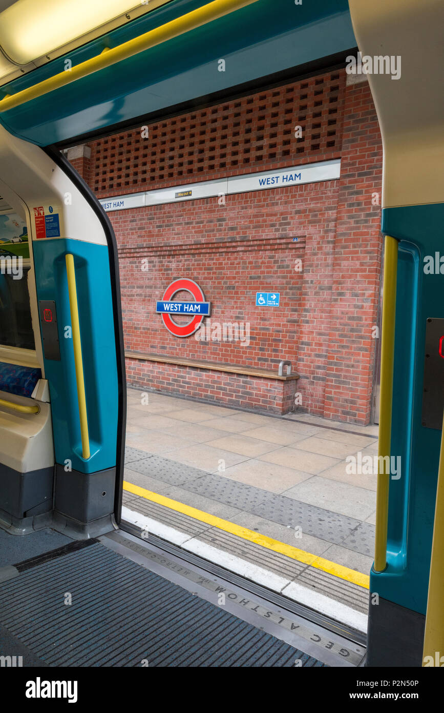 west ham underground station on the tube. TFL and transport for london view of platform from train doors. - Stock Image