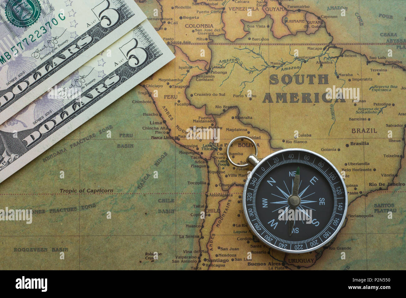 Ancient Map Of South America With Usa Money And A Compass Close Up Stock Photo Alamy