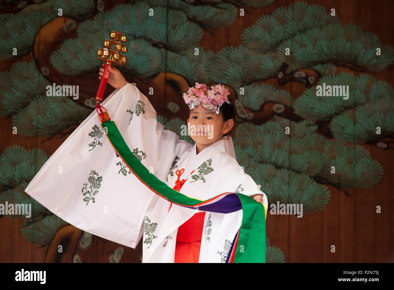 Girl dancing in traditional costume during Sanja Matsuri in Asakusa, Taito-ku, Tokyo, Japan - Stock Image
