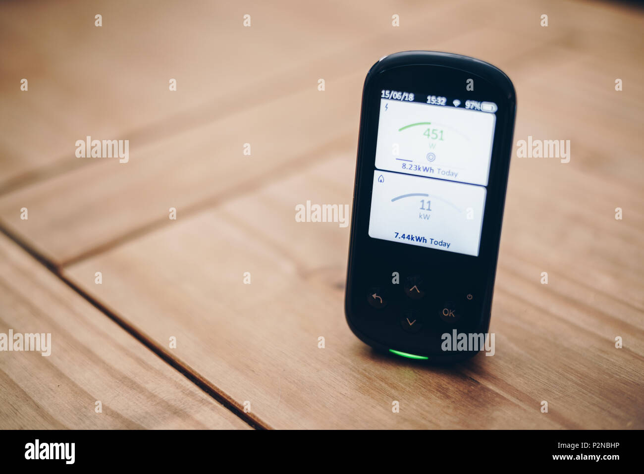 Domestic Energy Smart Meter on a living room coffee table, Displaying Energy Usage in Real Time - Stock Image