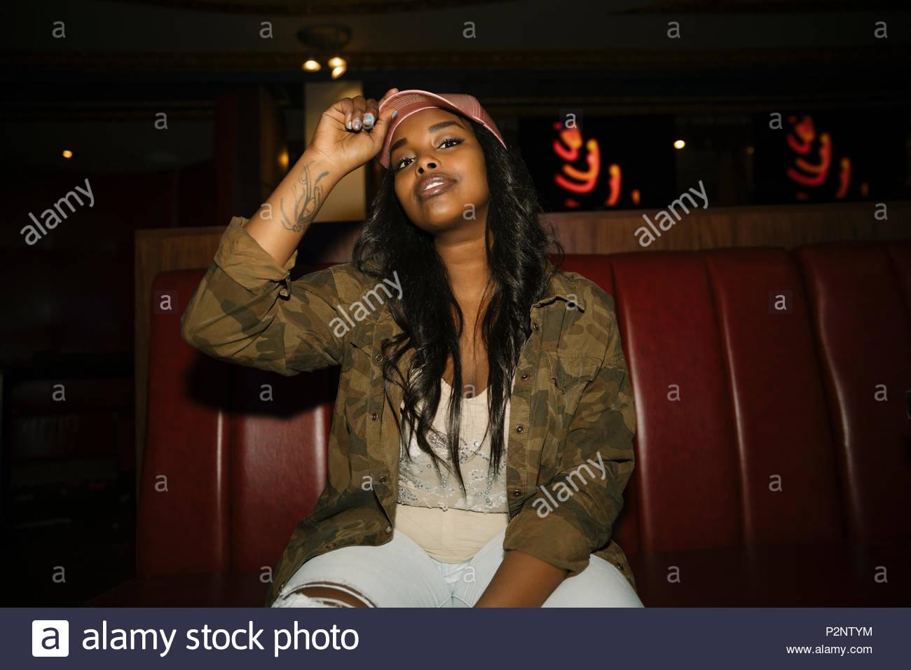 Portrait confident, cool, stylish female millennial in nightclub - Stock Image