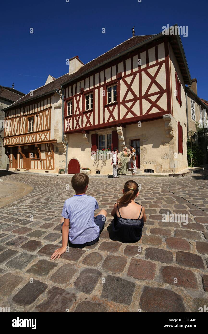 France, Yonne, Morvan region, Avallon, children watching a street show in front of a beautiful half timbered house in the historic city center - Stock Image