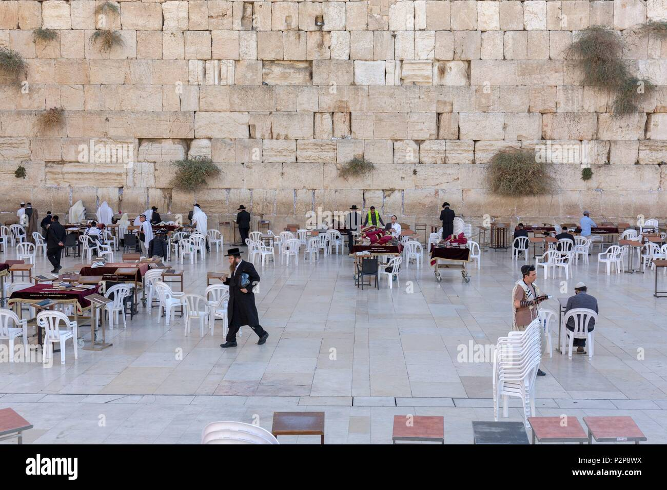 Israel, Jerusalem, the UNESCO World Heritage Old City, the Western Wall or Wailing Wall, Men in Prayer - Stock Image