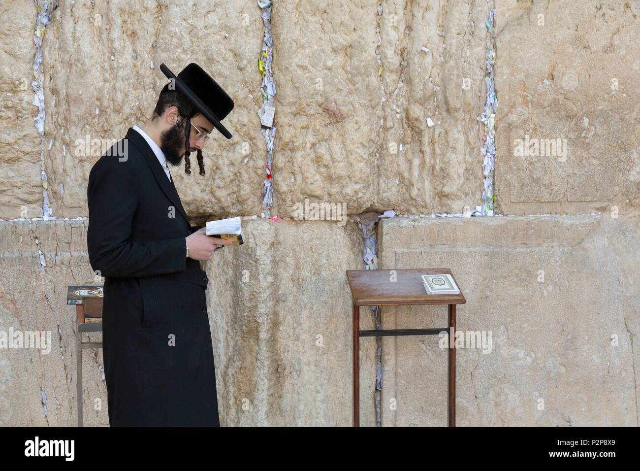 Israel, Jerusalem, UNESCO World Heritage Old Town, Western Wall or Wailing Wall, Praying Man, Hasidic Jew - Stock Image