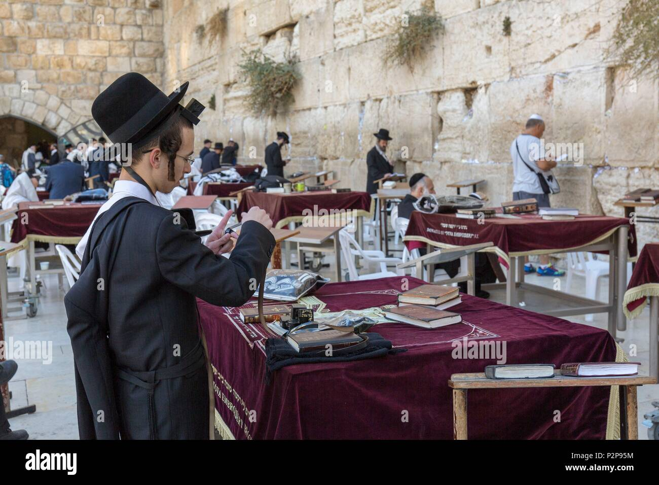 Israel, Jerusalem, the UNESCO World Heritage Old Town, the Western Wall or Wailing Wall, Praying Men, Hasidic Jew - Stock Image