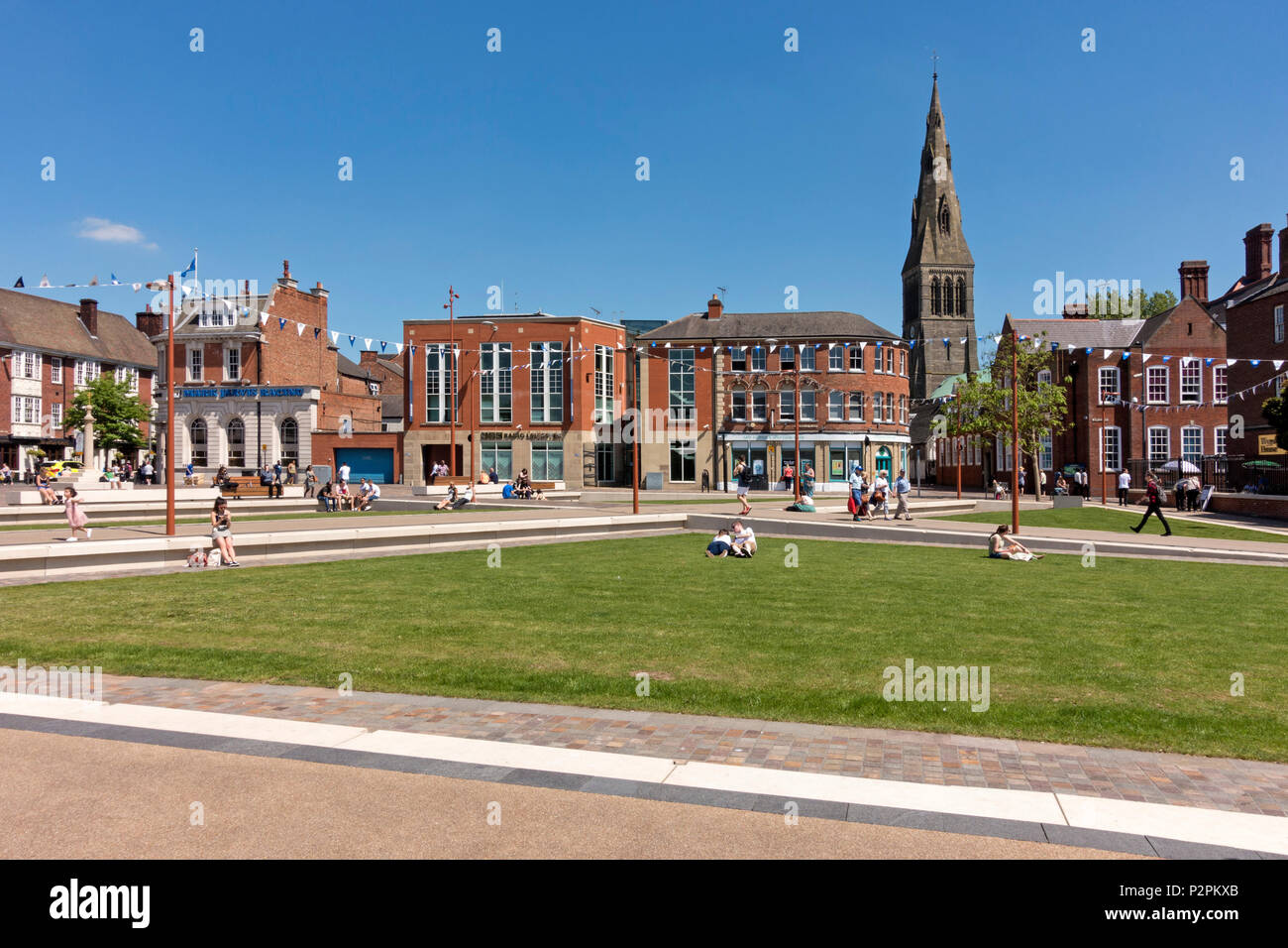 A sunny day in Jubilee Square, a green open space in the centre of Leicester City, England, UK - Stock Image