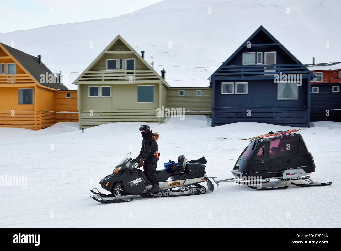 Norway, Svalbard, Spitzbergen, Longyearbyen, snowmobile with the kids in the closed trailer - Stock Image