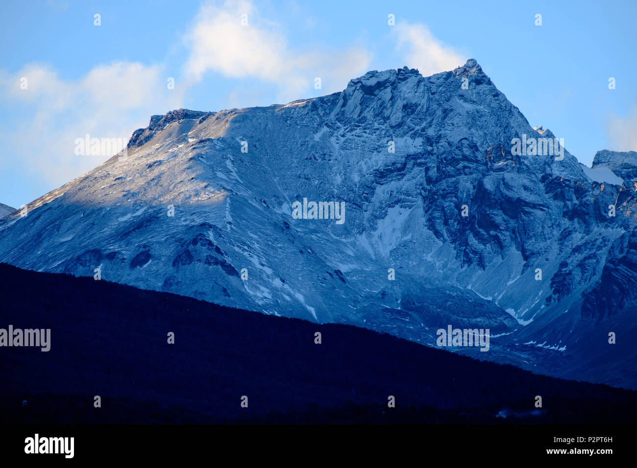One of the Martial mountains that surround Ushuaia seemingly has a blue colour. It received little snow that slightly changed its colour. - Stock Image