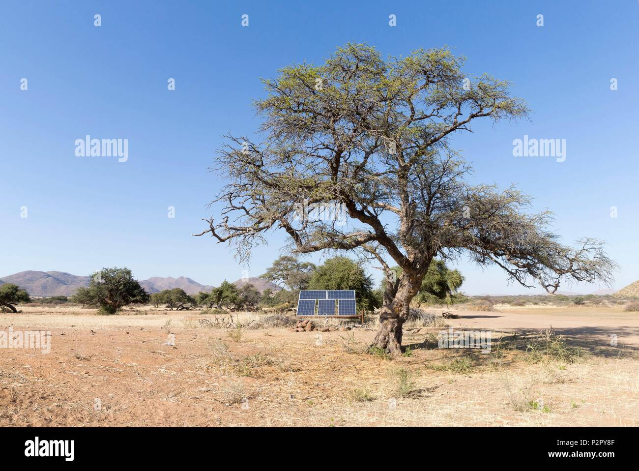 South Africa, Kalahari Desert, solar panels to power a pump that brings water into a water hole - Stock Image