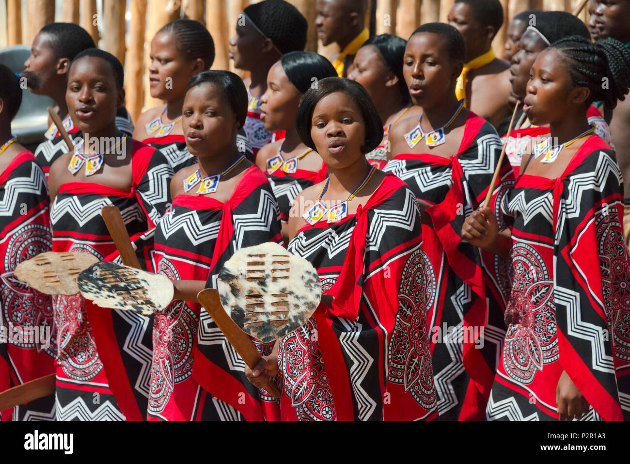 Swazi girls in traditional clothing dancing, Mantenga Cultural Village, Swaziland - Stock Image