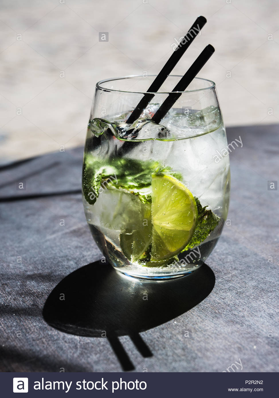 cocktail with lime , ice and peppermint leaves - Stock Image