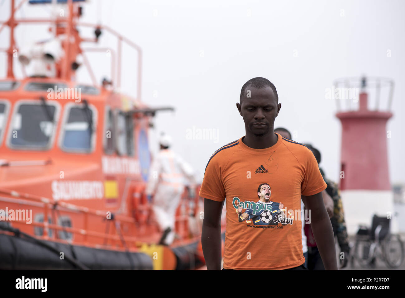 Motril, Granada, Spain. 15th June, 2018. A migrant seen walking on the port after being rescued. 45 men and 8 women have been rescued from a dinghy and brought at Motril port. Today June 15, Spanish Maritime Rescue Safety have rescued 211 people in the Alboran Sea from five dinghies and also 471 people from 47 dinghies have been rescued in El Estrecho, 4 people have died. Credit: Carlos Gil/SOPA Images/ZUMA Wire/Alamy Live News - Stock Image