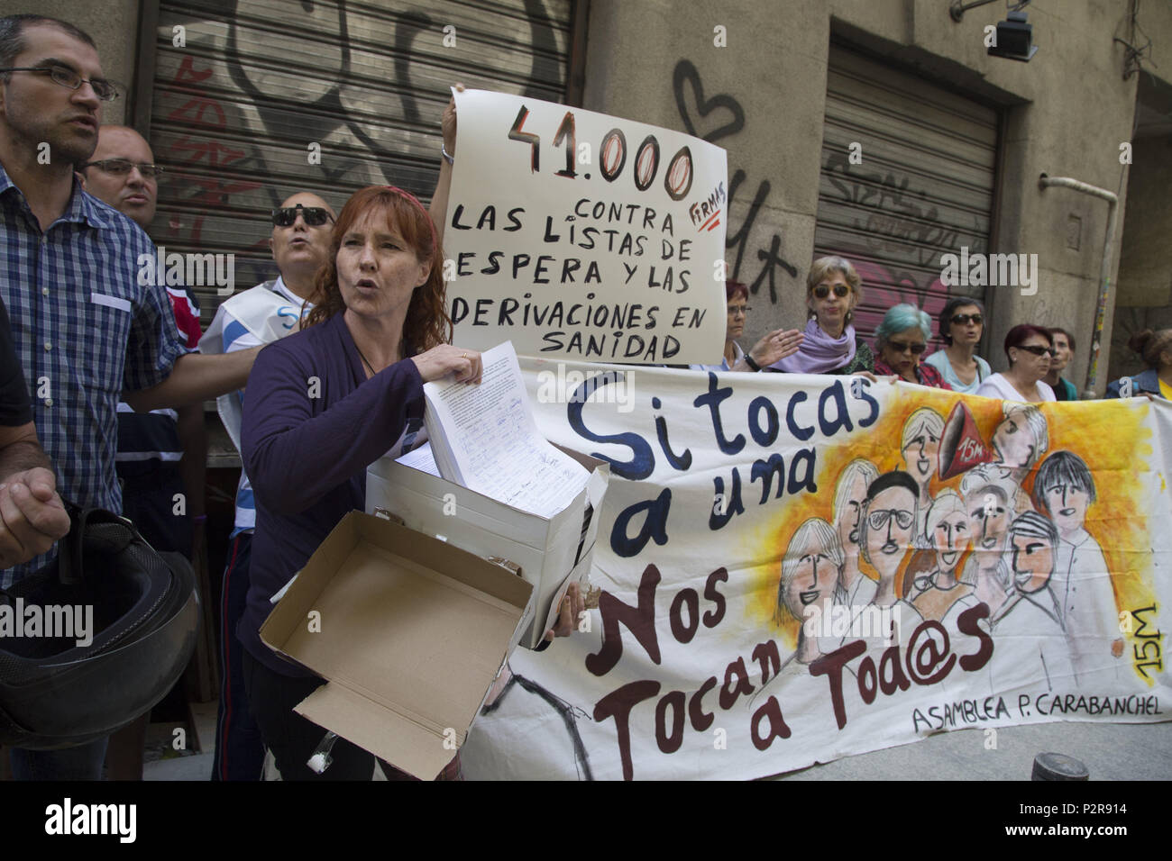 June 14, 2018 - Madrid, Spain - Demonstrators teach the collected signatures..Delivery of 41 000 signatures against waiting lists and referrals from public health to private healthcare. (Credit Image: © Lito Lizana/SOPA Images via ZUMA Wire) - Stock Image