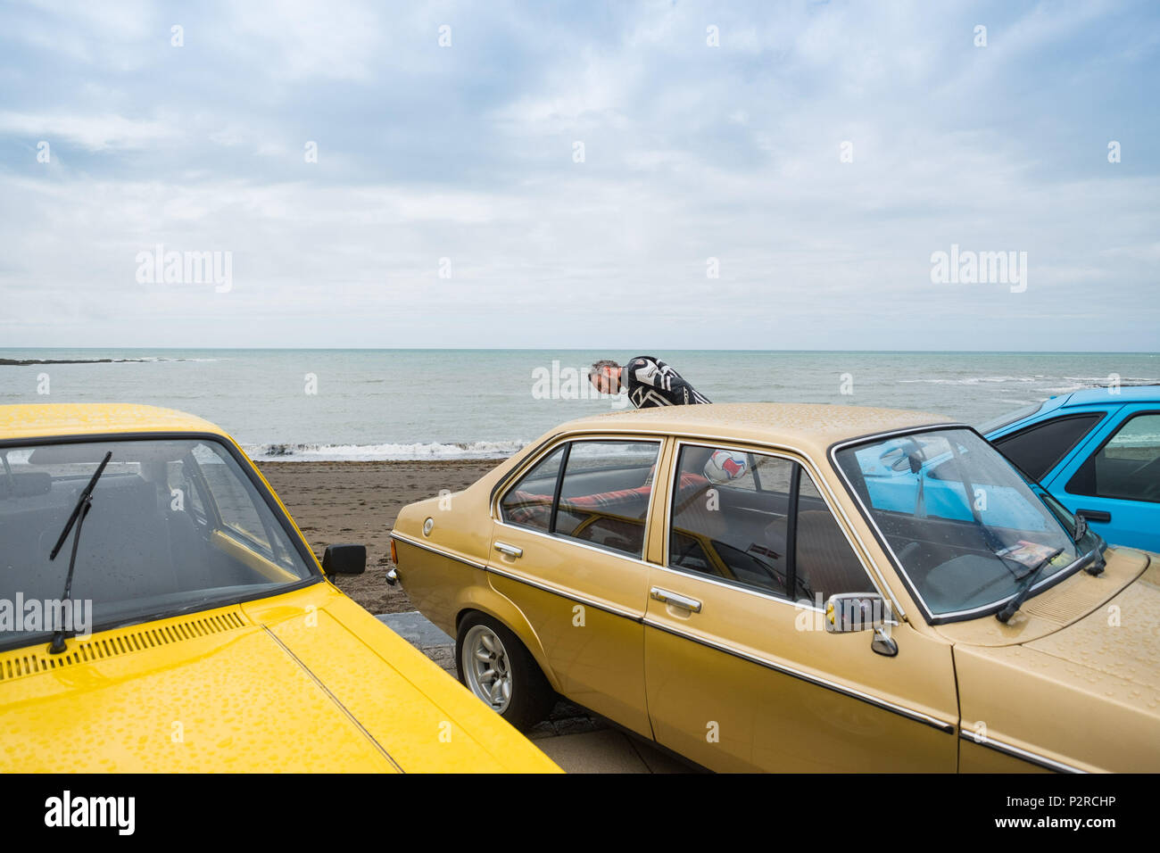 Aberystwyth Wales UK Saturday 16 June 2018  People on the promenade in Aberystwyth admiring a display of iconic  sports and classic cars, in a charity event organized by the local branch of the Rotary Club.    photo © Keith Morris / Alamy Live News - Stock Image