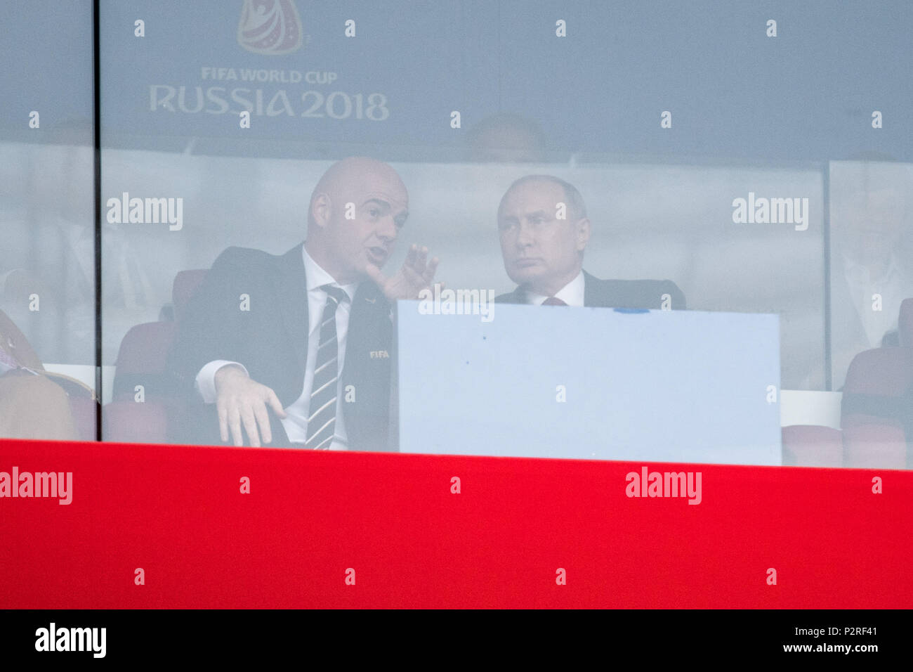 Gianni INFANTINO (left, President, FIFA) and Vladimir Vladimirovich Putin (Russian President), conversing, talking, talking, half figure, half figure, opening speech, opening, celebration, gesture, gesture, Russia (RUS) - Saudi Arabia ( KSA) 5: 0, preliminary round, group A, match 1, on 14.06.2018 in Moscow; Football World Cup 2018 in Russia from 14.06. - 15.07.2018. | usage worldwide - Stock Image