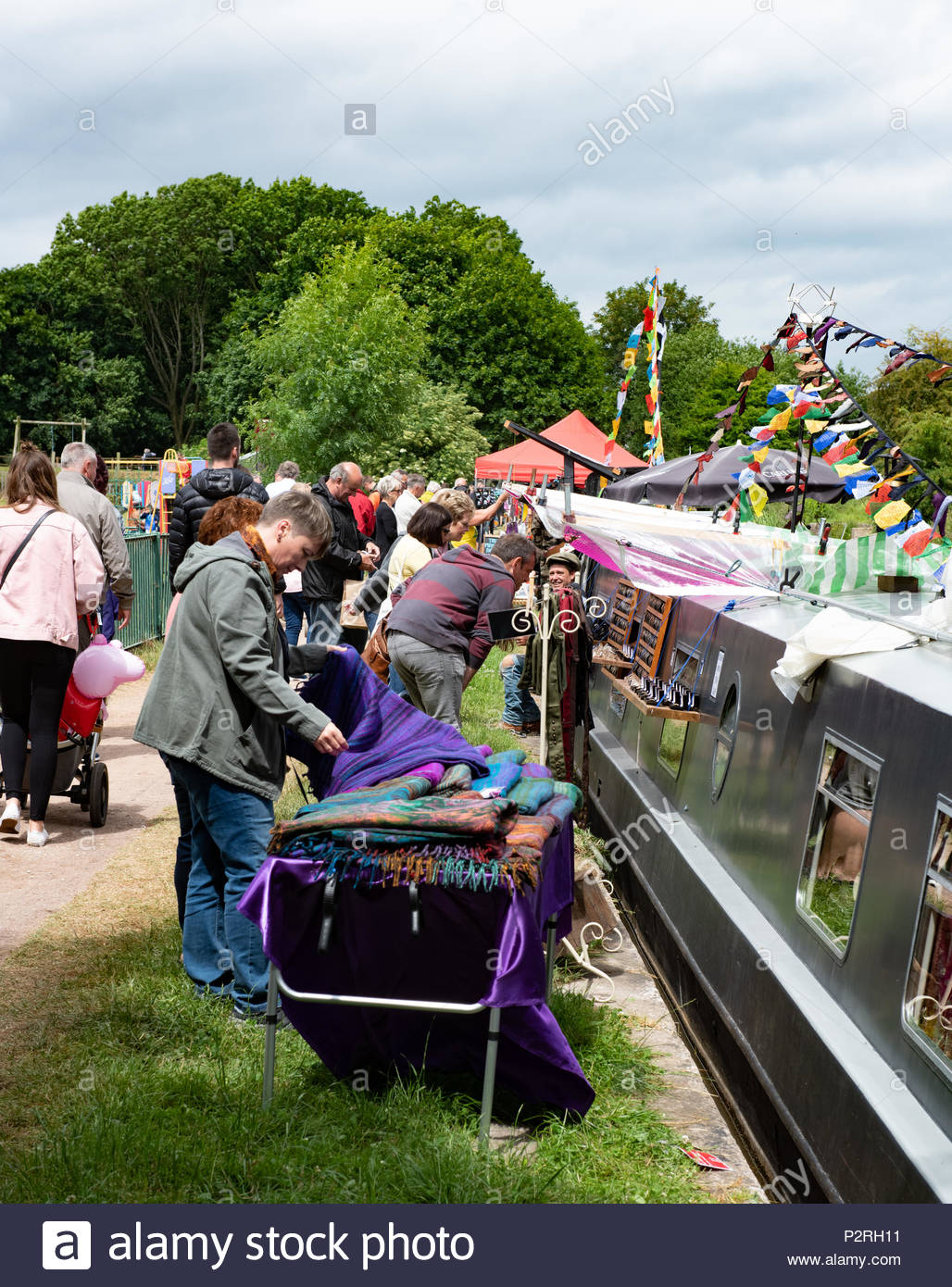 Middlewich, UK. 16th, June, 2018. Visitors enjoyed visiting the floating market at the Middlewich Folk and Boat Festival held in the Cheshire town over the weekend. Music and entertainment was on offer to visitors​ to the annual event including the crowning of the Rose Queen 2018/19 © Phil Pickin/ Alamy Live News - Stock Image