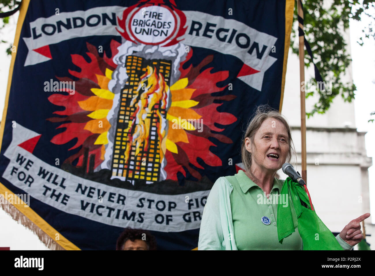 London, UK. 16th June, 2018. Eileen Short of Defend Council Housing addresses the Justice for Grenfell solidarity rally outside Downing Street organised by Justice4Grenfell and the Fire Brigades Union two days after the first anniversary of the Grenfell Tower fire during which 72 people died and over 70 were injured. - Stock Image
