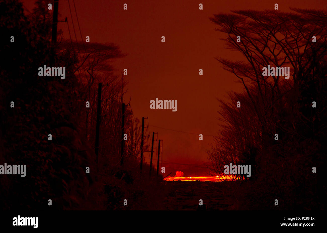 Pahoa, Hawaii, USA. 9th June, 2018. A river of molten lava moves past a partially blocked road in Leilani Estates as the Kilauea Volcano lower east rift zone continues its eruption on Wednesday, June 6, 2018, in Pahoa, Hawaii. Credit: L.E. Baskow/ZUMA Wire/Alamy Live News - Stock Image